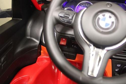 Детский электромобиль BMW X6M (JJ2168) красный